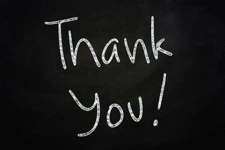 regard: Thank You Lettering, written with Chalk on Blackboard Stock Photo