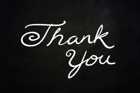 you are welcome: Thank You Lettering, written with Chalk on Blackboard Stock Photo