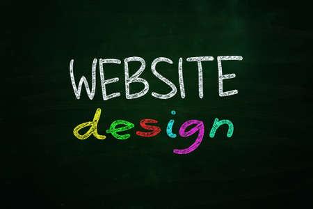 Website Design Lettering, written with Color Chalk on Blackboard Stock Photo - 24614968