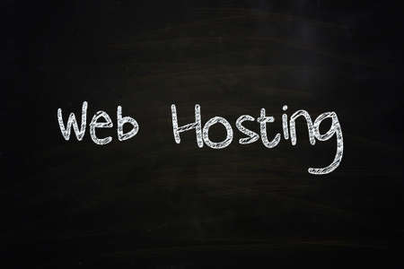 Web Hosting Lettering, written with Chalk on Blackboard Stock Photo - 24614983