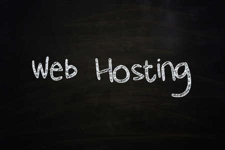 Web Hosting Lettering, written with Chalk on Blackboard Stock Photo - 24614983