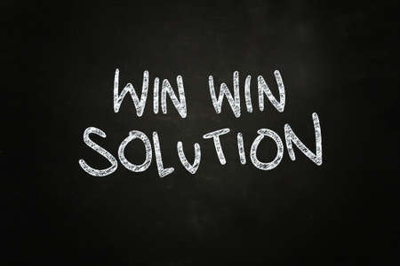 Win Win Solution Lettering, written with Color Chalk on Blackboard photo