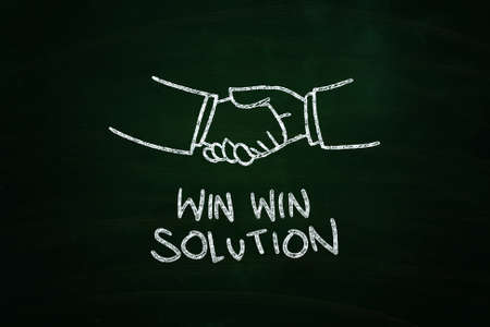 Win Win Solution Lettering, written with Chalk on Blackboard 版權商用圖片