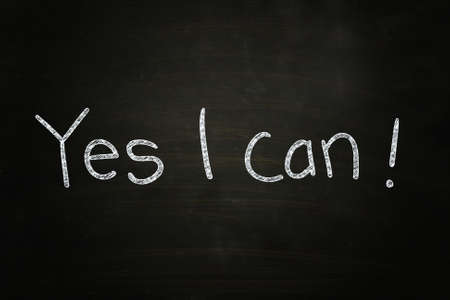 Yes I Can, Motivational Phrase written with Chalk on Blackboard photo