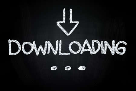 Downloading Writting with Down Sign Arrow, drawn with Chalk on Blackboard Stock Photo - 24808109