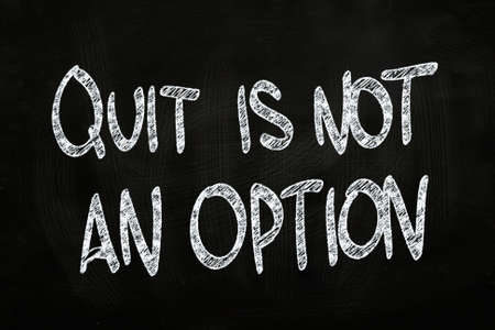 not give: Quit is Not an Option, Motivational Phrase written with Chalk on Blackboard