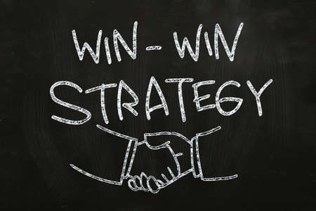 Win Win Strategy quotes and hand shakes, drawn with Chalk on Blackboard