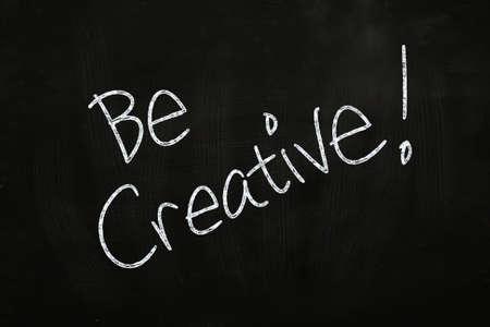 Be Creative Lettering, written with Chalk on Blackboard