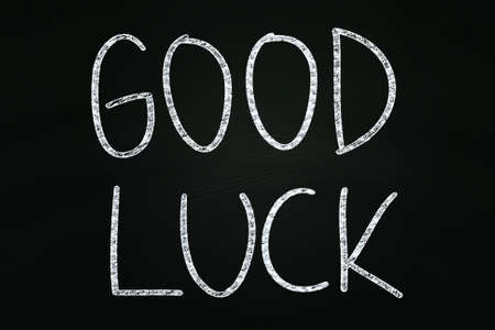 Good Luck writing, written with Chalk on Blackboard photo