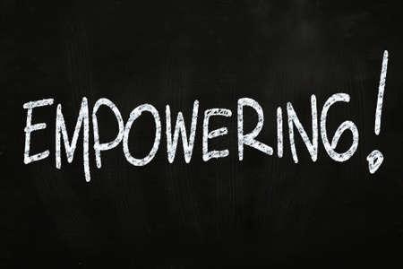 Empowering writing, written with Chalk on Blackboard Stock Photo
