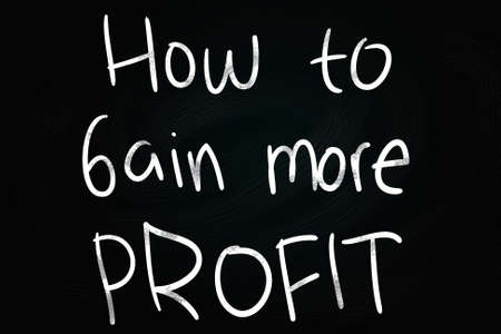 How to Gain More Profit writing, written with Chalk on Blackboard photo