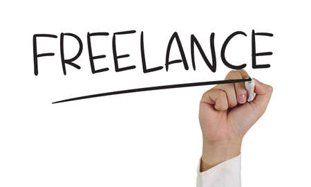 freelancer: Business concept image of a hand holding marker and write Freelance word isolated on white