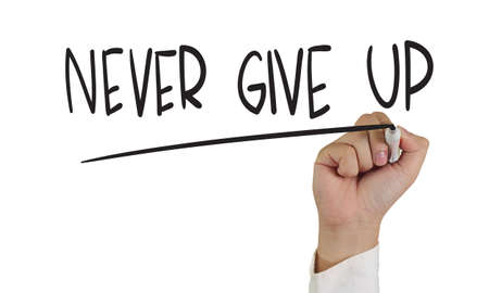 never: Business concept image of a hand holding marker and write Never Give Up isolated on white