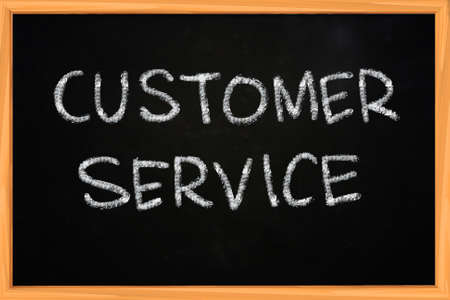 cs: Customer Service illustration of chalk writing on blackboard Stock Photo