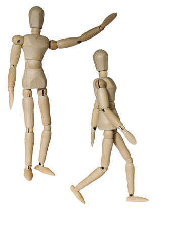 Wooden mannequin in two different pose of walking and raising arm isolated on white photo