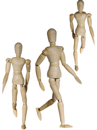 Wooden mannequin in three different walking pose isolated on white photo