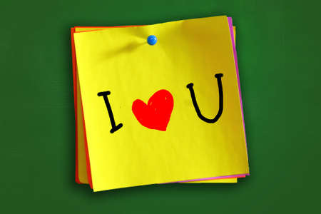 i love you sign: The word I love You with heart symbol written on sticky colored paper
