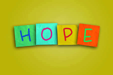 The word Hope written on sticky colored paper photo