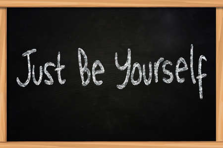 The words Just Be Yourself written with chalk on blackboard photo