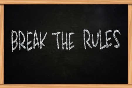 The words Break The Rules written with chalk on blackboard photo