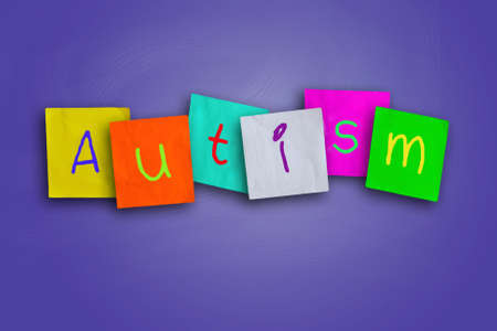 The word Autism written on sticky colored paper
