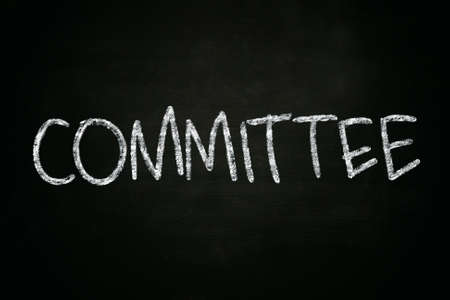 committee: The word Committee written with chalk on blackboard Stock Photo