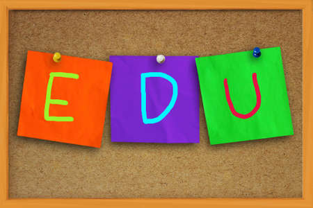 edu: The word EDU written on sticky colored paper over cork board Stock Photo