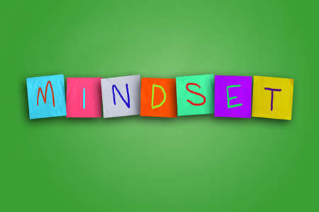 self improvement: The word Mindset written on sticky colored paper
