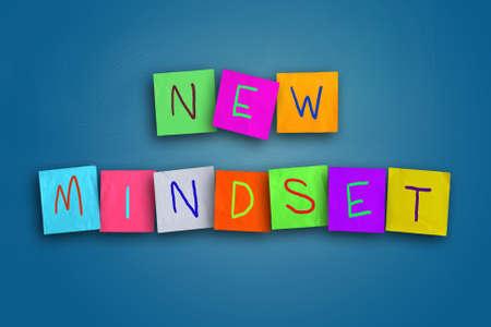 De woorden New Mindset geschreven op sticky gekleurd papier
