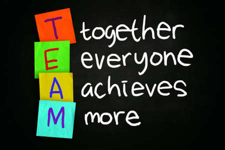 The words TEAM together everyone achieves more written on chalkboard