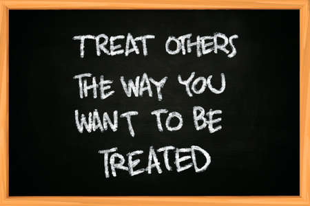treated: The words Treat others the way you want to be treated written with chalk on blackboard