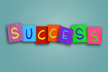 colored paper: The word Success written on sticky colored paper