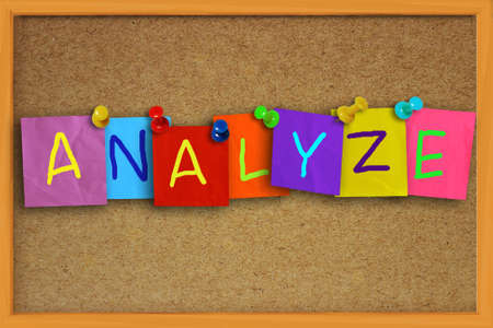 colored paper: Image of the word Analyze written on sticky colored paper over cork board Stock Photo