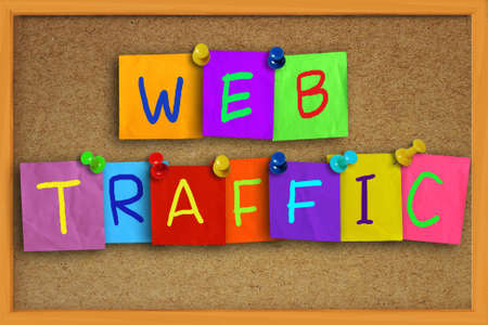 the optimizer: Internet concept image of the word Web Traffic written on sticky colored paper over cork board Stock Photo