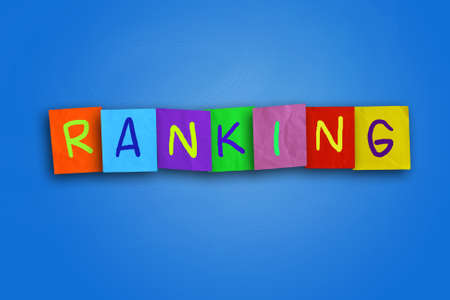 colored paper: The word Ranking written on sticky colored paper over blue background Stock Photo