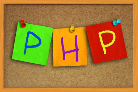 colored paper: The word PHP written on sticky colored paper over cork board