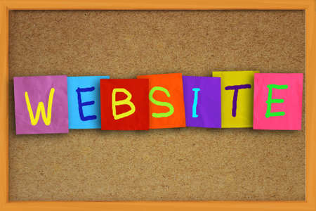 colored paper: The word Website written on sticky colored paper over cork board