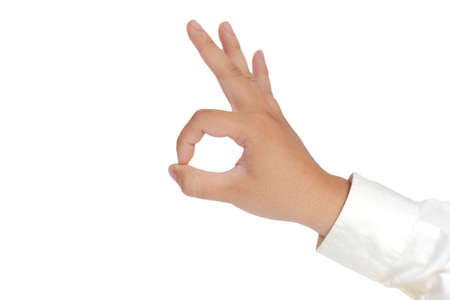 long sleeved: Gesture of hand showing OK sign with fingers in formal long sleeved shirt isolated on white