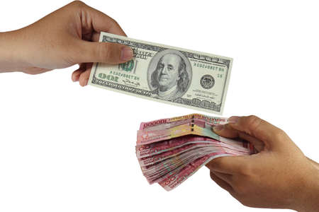 Hands doing money exchange of Dollar and Rupiah isolated on white Stock Photo