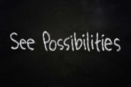 possibilities: Business motivational concept the words See Possibilities written with chalk on blackboard