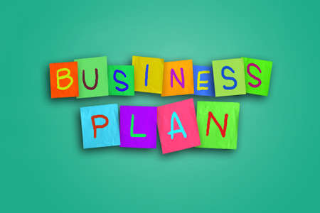 color theory: The words Business Plan written on sticky colored paper