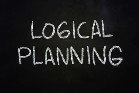 logical: Business concept the words Logical Planning written with chalk on blackboard