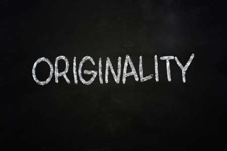 originality: Motivational concept the word Originality written with chalk on blackboard