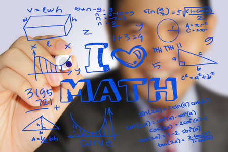 Educational concept image of a happy teacher holding marker and write I Love Math with mathematics formulas doodle