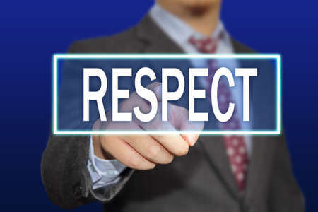dignity: Business concept image of a businessman clicking Respect button on virtual screen over blue background