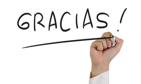 grateful: Motivational concept image of a hand holding marker and write Gracias isolated on white