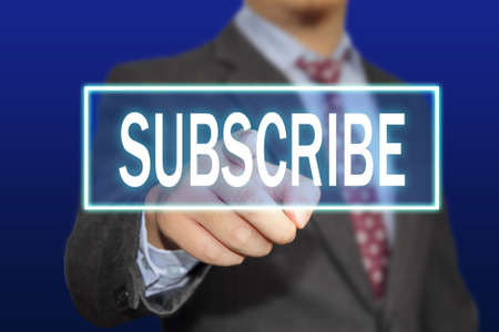 clicking: Business concept image of a businessman clicking Subscribe button on virtual screen over blue background