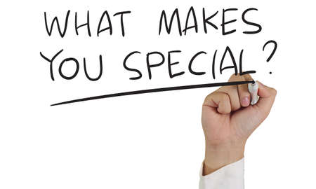 you are special: Motivational concept image of a hand holding marker and write What Make You Special isolated on white