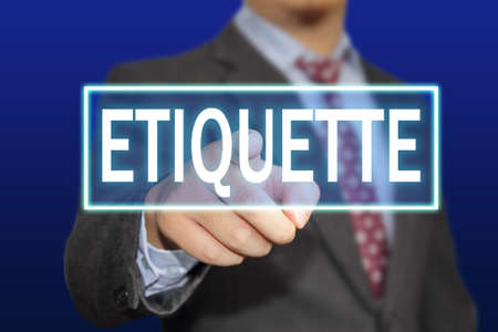 etiquette: Business concept image of a businessman clicking Etiquette button on virtual screen over blue background