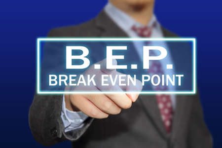 even: Business concept image of a businessman clicking BEP or break even point button on virtual screen over blue background Stock Photo